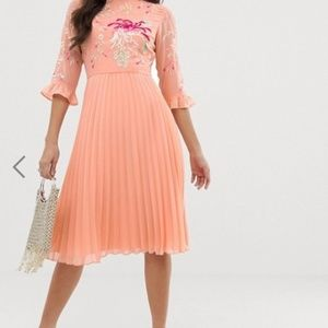 Embroidered pleated midi dress with fluted sleeve